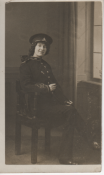 Photograph of Gladys, a teenage girl, dressed in the uniform of the Royal Artillery, c.1914