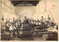 A ward at the 'Welch' Hospital, Deolali. Margaret is standing on the left. Thanks to Dave Gordon.